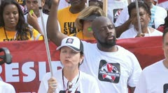 Wyclef Jean walking in AIDS parade Stock Footage