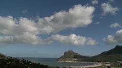 Puffy clouds rolling over sunny bay,Hout Bay .Time lapse Stock Footage