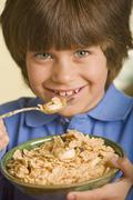 Hispanic boy eating cereal Stock Photos
