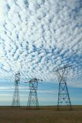 Three electrical power pylons - stock photo