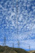 Electrical power cables and pylons - stock photo