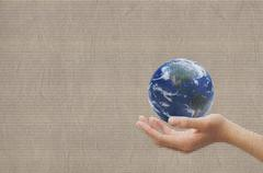 Hand showing earth on texture recycled paper background Stock Illustration