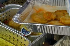 Cooking fried green tomatoes Stock Footage