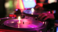 DJ Mixes and Scratches in Nightclub Stock Footage