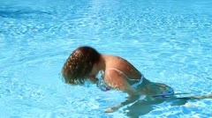 Woman have fun in the pool Stock Footage