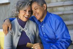 Multi-ethnic couple hugging Stock Photos