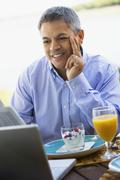 Hispanic man at breakfast table Stock Photos