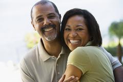 African couple hugging Stock Photos