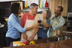 multi-ethnic friends toasting with wine - stock photo