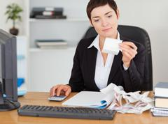 Professional office worker doing accountancy - stock photo
