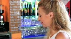 Woman enjoying a drink Stock Footage