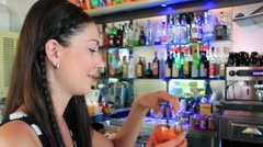 Woman enjoying a drink Stock Footage