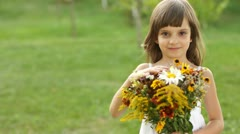 Smiling girl with bouquet of flowers Stock Footage
