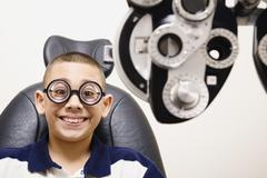 Asian boy in eye doctor's office Stock Photos