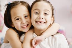 Asian sisters hugging Stock Photos