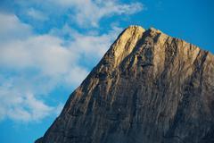 evening light on mountain peak - stock photo