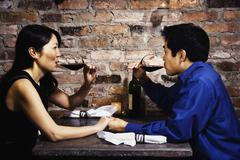 asian couple drinking wine - stock photo
