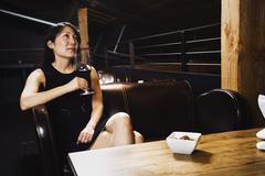 Asian woman drinking wine Stock Photos