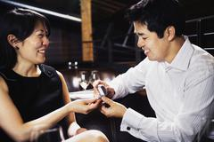 Asian man proposing to girlfriend Stock Photos