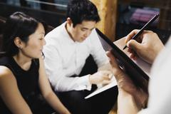Asian couple ordering food at restaurant Stock Photos