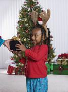 african girl accepting christmas gift - stock photo