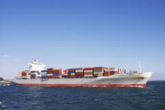 Container ship leaving port Stock Photos