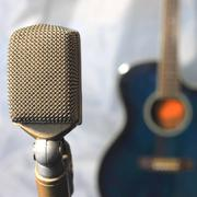 Old microphone with guitar Stock Photos
