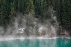 Rising mist from alpine lake 02 Stock Photos
