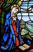 stained glass scene of the virgin mary - stock photo