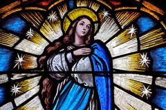 Stained glass scene of the virgin mary Stock Photos