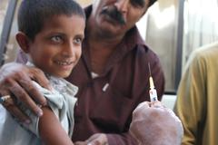 Refugee Boy getting Cholera Vaccination in Pakistan Stock Photos