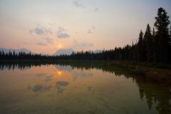 Stock Photo of sunset on mountain lake