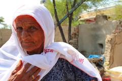 Old Pakistani Woman Assesses Damage done by Floods in 2010 - stock photo