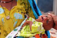 Sick Refugee Baby Crying in Shikarpur, Pakistan Stock Photos
