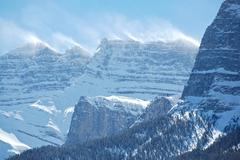 Snow spindrift on mountain peak 02 Stock Photos