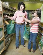 Asian mother and daughter shopping in health food store - stock photo