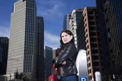 Hispanic woman in urban scene Stock Photos