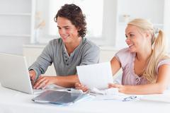 Happy couple accounting - stock photo