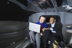 Multi-ethnic businessmen looking at laptop Stock Photos