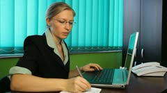 Businesswoman working at her desk secretary job blonde office, corporate, office - stock footage