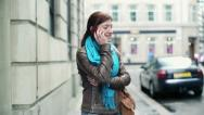 Happy woman talking on cellphone in the city HD Stock Footage