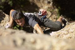 Stock Photo of Argentinean man rock climbing