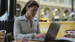 Young woman working on modern laptop in cafe HD - stock footage