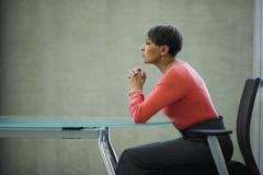 African businesswoman looking serious at conference table Stock Photos