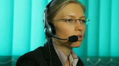 Pan of busy woman at call center hotline sale consultant helpline corporate girl - stock footage