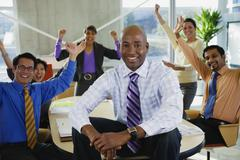 Multi-ethnic business people celebrating in meeting Stock Photos