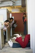 Multi-ethnic business people watching office romance Stock Photos