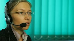 Pan of woman smile talking at call center hotline sale close-up corporate girl - stock footage