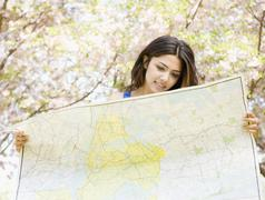 Middle Eastern woman holding map Stock Photos