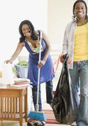 African couple cleaning house Stock Photos